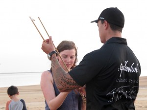 Learning to throw a spear with a woomera
